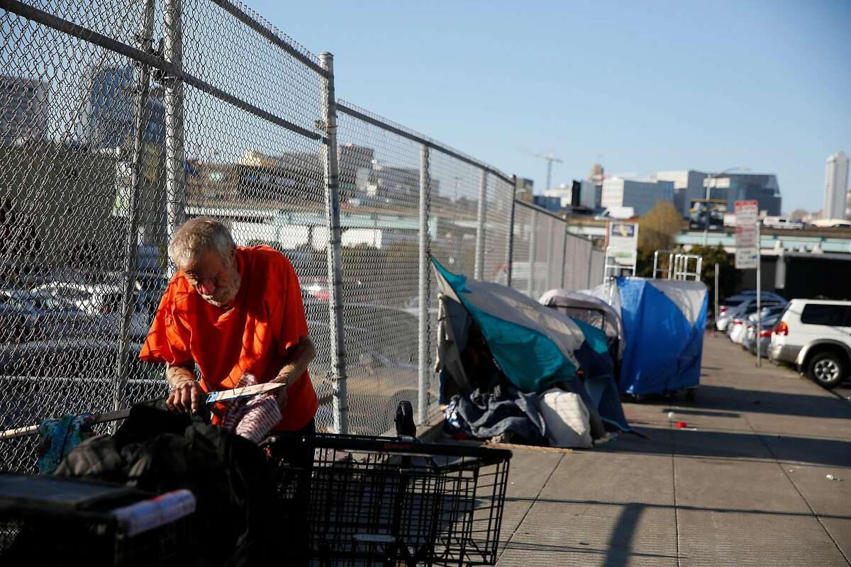 Bill Smith makes preparations at the site where he is planning to sleep for the night on Wednesday, March 4, 2020 in San Francisco, Calif. Smith says he has been dealing with homelessness on and off for approximately 20 years.