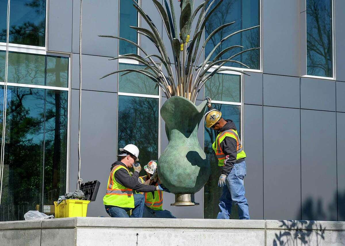 """Construction workers move the sculpture """"Pitcher with Flowers"""" by Sam Houston State University alumni James Surls is moved into place at the site of the university's new College of Osteopathic Medicine, Feb. 14, 2020, in Conroe."""