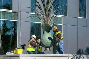 "Construction workers move the sculpture ""Pitcher with Flowers"" by Sam Houston State University alumni James Surls is moved into place at the site of the university's new College of Osteopathic Medicine, Feb. 14, 2020, in Conroe."