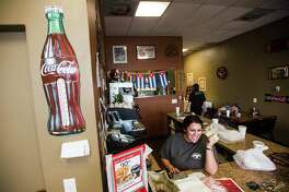 Sharon Glaze rings up a customer's order at Tico's Cuban Cafe on Wednesday afternoon. Tico's Cuban Cafe in Bridge City is the Cat5 Restaurant of the Week for December 11, 2014. Photo taken Wednesday 12/3/14 Jake Daniels/The Enterprise