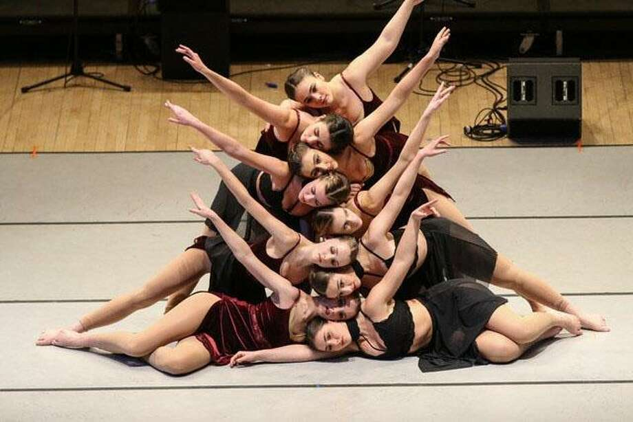 """Studio D in New Milford recently took the stage at Carnegie Hall in New York City. Performers are shown above in their new piece, """"Glass Carousel."""" choreographed by Artistic Director Rebecca Anderson Darling. Students from the advanced motion class are, from top to bottom, Maria Pellegrino, Emmie Tesoriero, Sarah Rondini, Katie Bouzakis, Katie Hawley, Lindsey Federowicz, Rachael Tomanelli, Katie Lukens and Alexa Esposito. Photo: Courtesy Of Jenny Lukens / The News-Times Contributed"""