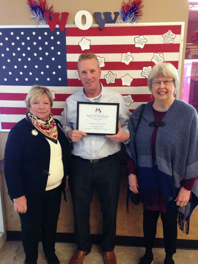 The Roger Sherman Chapter, National Society Daughters of the American Revolution, which serves the Greater New Milford area, recently present a flag certificate to Big Y in New Milford. Above, Regent Bonnie Butler, left, and Flag of the USA Chairwoman Judy Messer present the certificate to Big Y Manager Brian Murtha. Photo: Courtesy Of Roger Sherman Chapter, NSDAR / The News-Times Contributed