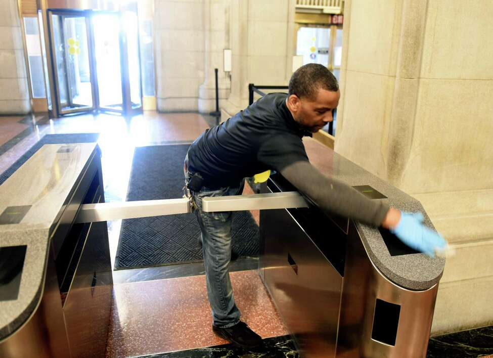Capitol security turnstiles are disinfected to help curve the spread of coronavirus on Tuesday, March 10, 2020, in Albany, N.Y. (Will Waldron/Times Union)