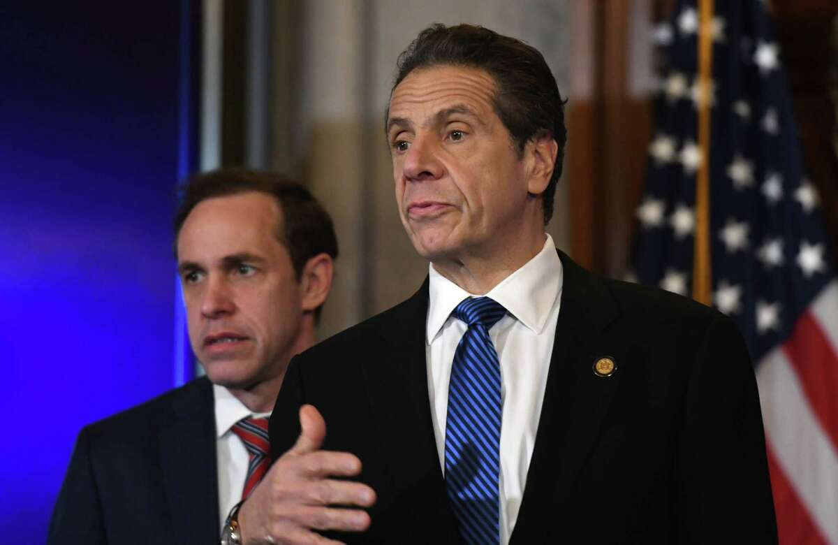 Gov. Andrew Cuomo, right, and State Department of Health Commissioner Dr. Howard Zucker, left, answers questions during a news briefing where he provided updates on state coronavirus infections, and measures being taken to mitigate its dispersion on Tuesday, March 10, 2020, in the Red Room at the Capitol in Albany, N.Y. (Will Waldron/Times Union)