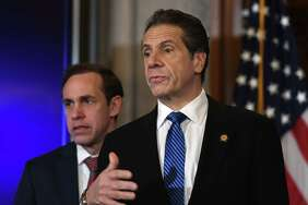 Gov. Andrew Cuomo, right, and State Department of Health Commissioner Howard Zucker, left, have refused to disclose how many nursing home residents in New York have died from COVID-19, despite frequent requests for the answer from lawmakers and reporters. Cuomo and Zucker are shown during a March 10 press conference in the Red Room at the Capitol in Albany, N.Y. (Will Waldron/Times Union)