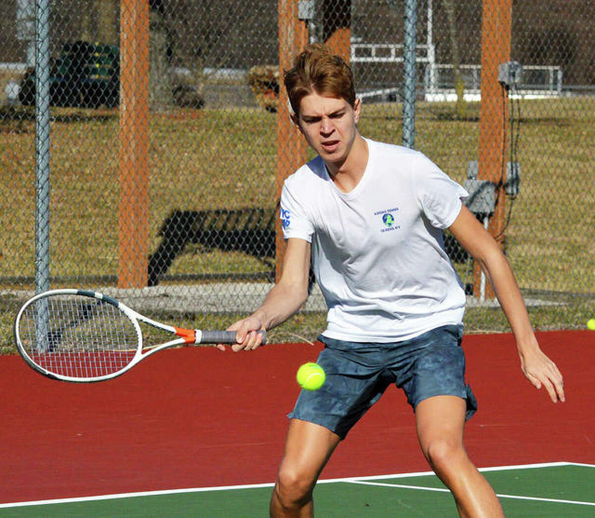 Edwardsville junior Ben Blake returns a shot during practice on Tuesday. Blake is one of several players competing for the No. 1 singles position.