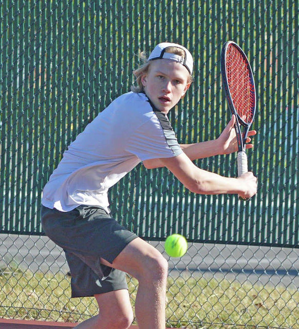 Edwardsville sophomore Sam Motley makes a backhand return during practice on Tuesday. Motley is one of several players competing for the No. 1 singles position.
