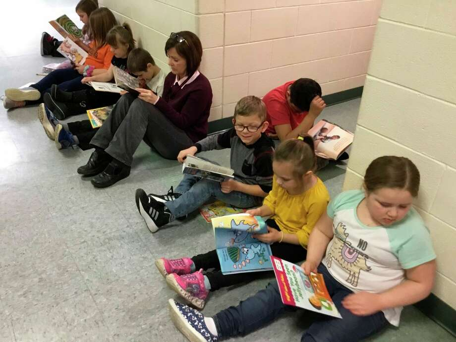 Bear Lake students lined the hallways of their school this week to enjoy a good book as part of National Reading Month. (Courtesy photo)