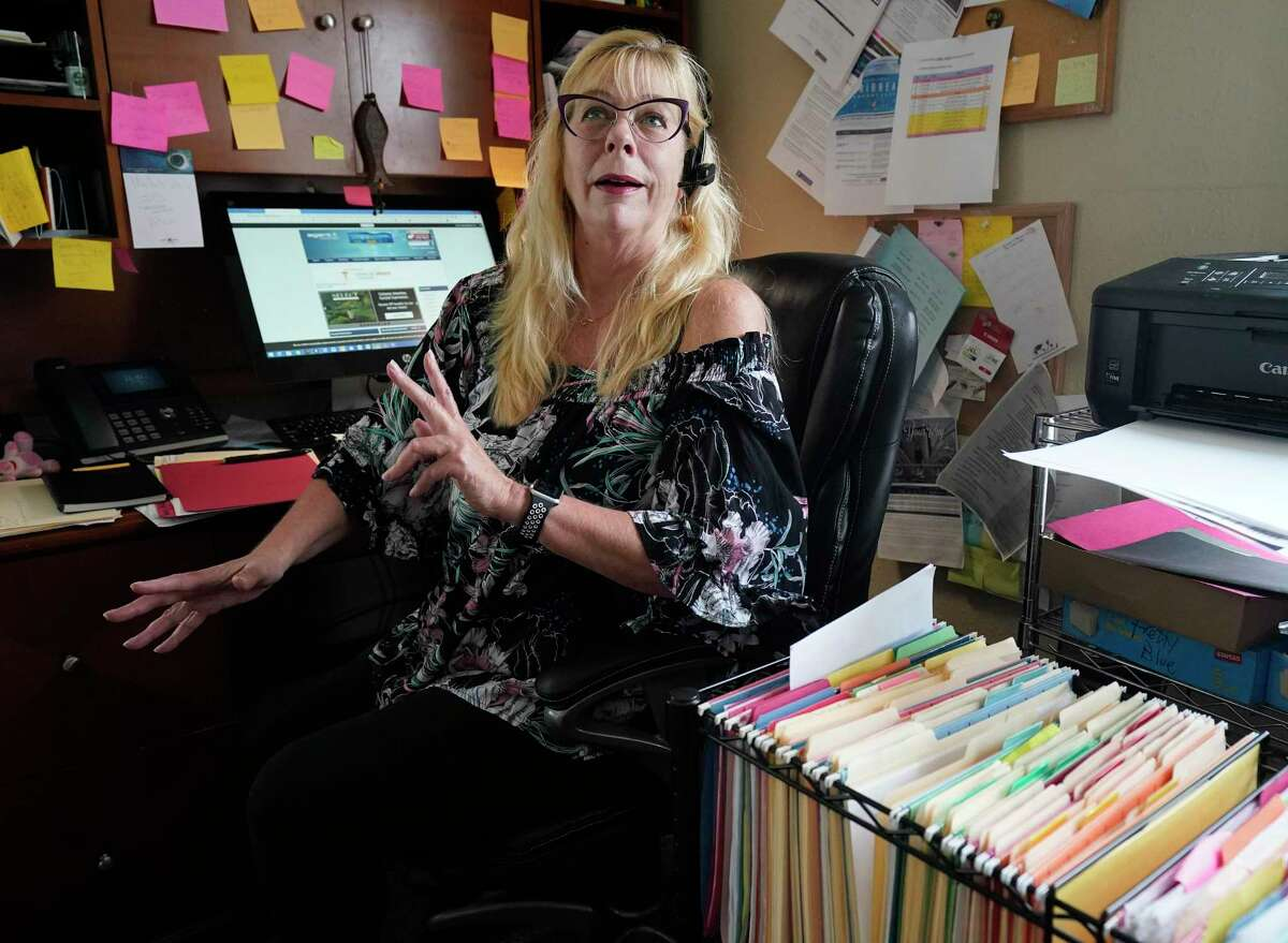 Nannette Metoyer, owner of CruiseCats.com travel agency, works in her office Tuesday, March 10, 2020, in Galveston. She said she has already seen a few people cancel or reschedule their bookings because of the virus. She has a very levelheaded response to the virus having seen similar virus outbreaks in the past lead to fluctuations in cruise sales.