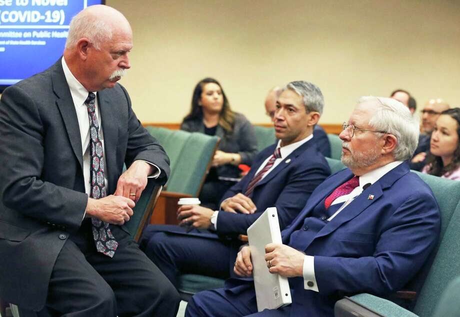 Houston public health authority Dr. David Persse, left, talks to Texas Department of Health Services Commissioner Dr. John Hellerstedt, right, during a Legislative hearing about the coronavirus threat on March 10. Listening to the conversation is San Antonio Mayor Ron Nirenberg. Photo: Tom Reel, San Antonio Express-News / **MANDATORY CREDIT FOR PHOTOG AND  SAN ANTONIO EXPRESS-NEWS/NO SALES/MAGS OUT/TV