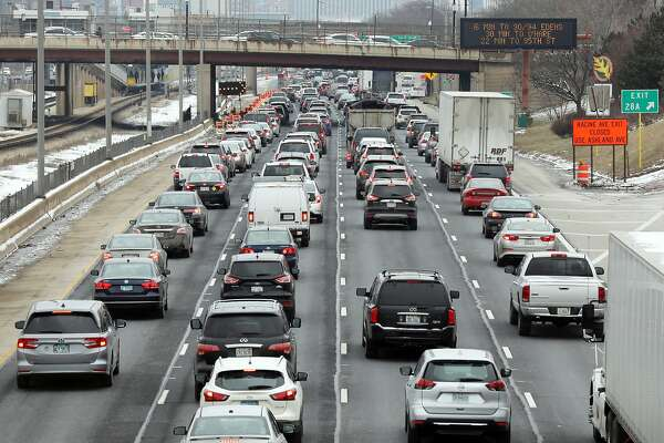 Traffic grinds to a halt on the inbound Eisenhower Expressway as motorists begin hitting the brakes around Leavitt Street in Chicago on Feb. 11, 2019. Fatal car crashes in the U.S. spike by 6% during the workweek following the daylight saving time change, resulting in about 28 additional deaths every year, according to a study. (Terrence Antonio James/Chicago Tribune/TNS)