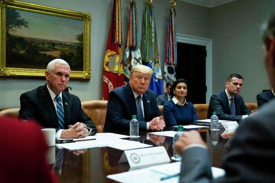President Donald Trump listens during a meeting on the coronavirus with health care company leaders, in the Roosevelt Room of the White House, Tuesday, March 10, 2020, in Washington. From left, Vice President Mike Pence, Trump, Administrator of the Centers for Medicare and Medicaid Services Seema Verma, and CEO of UnitedHealth Group Dave Wichmann. Photo: Evan Vucci / Associated Press / Copyright 2020 The Associated Press. All rights reserved