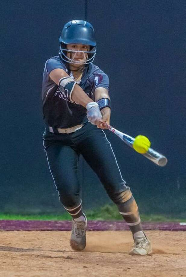 Pearland's Alayna Calvillo slaps the ball during a District 23-6A softball game Monday night against Dawson. Photo: Kim Christensen