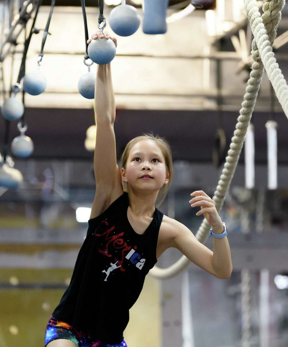 10 year old Meredith Kim works on the Cannon Balls during practice on Friday, March 6, 2020 at Iron Sports in Houston Texas.