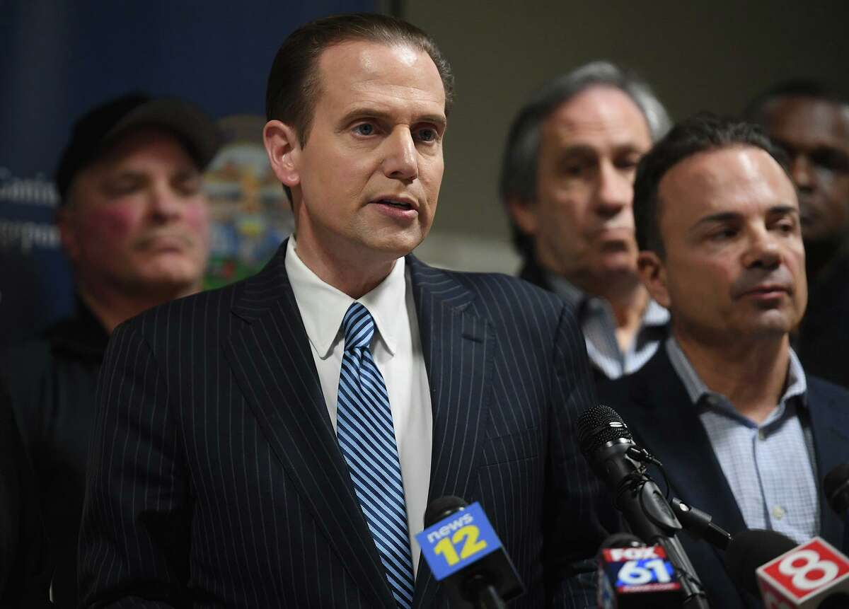 Flanked by Bridgeport Mayor Joe Ganim, right, Frank Recchia addresses the media during a press conference at the Margaret Morton Government Center in Bridgeport, Conn. on Tuesday, March 10, 2020. The body of Recchia's missing brother, Peter Recchia, a Middletown resident, was discovered in a wooded area in Wallingford. Frank Recchia is a well known local television news reporter.