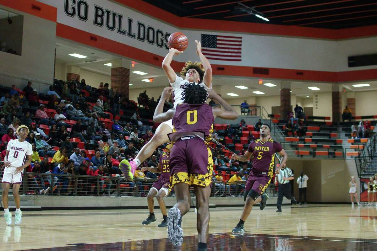 Summer Creek's JaVon Jackson (3) tries to put up a shot over Beaumont United's Kendris Henry (0) Tuesday, Feb. 3. at the La Porte High School Multi-Purpose Facility.