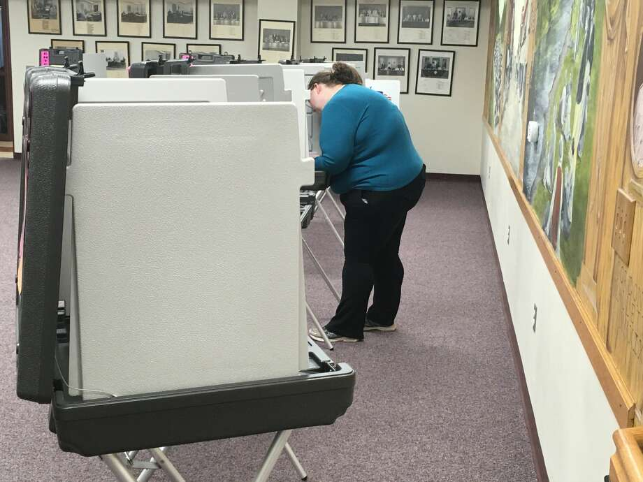 A voter at Big Rapids City Hall is pictured casting her vote Tuesday afternoon. Photo: Pioneer Photo/Tim Rath