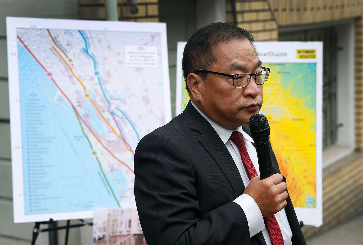 Tom Hui, director of the city's Department of Building Inspection, details the importance of seismic retrofitting at a news conference in front of a six-unit apartment building undergoing the work in San Francisco, Calif. on Thursday, Sept. 6, 2018. Owners of soft story buildings in the city have until Sept. 15 to file permits for earthquake retrofitting projects.
