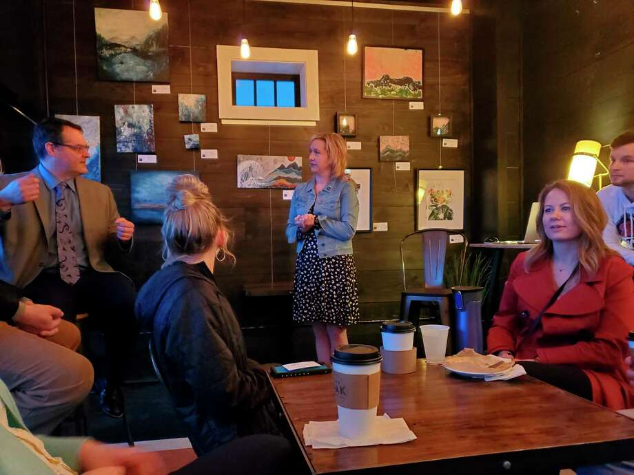 Michelle Pilaske, director of communications and programs for the Michigan Baseball Foundation, meets with Midland's Young Professionals group to talk about the idea of an art theater cinema on Tuesday, March 10, at Live Oak Coffeehouse in Midland. (Ashley Schafer/Ashley.Schafer@hearstnp.com)