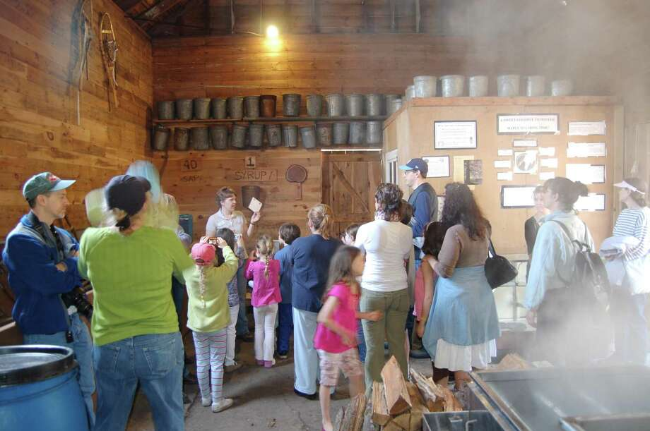 Sharon Audubon Center will hold its annual Maple Festival March 21. Above, guests take a guided tour of the center's maple sugaring operation. Photo: Sharon Audubon / Contributed Photo /