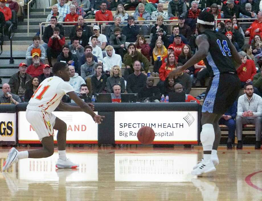 Ferris State freshman point guard Jeremiah Washington executes a bounce pass duringthe Bulldogs' 85-73 winagainst Grand Valley State on Jan. 2 at Jim Wink Arena. (Pioneer file photo/Joe Judd)