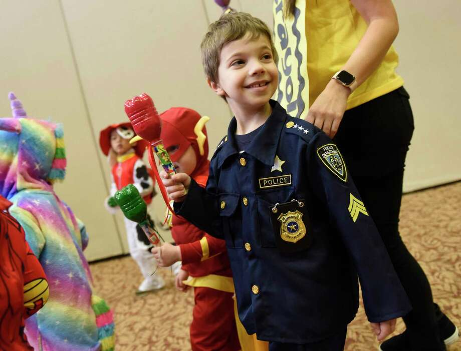 Preschooler Fuller Medhurst, dressed in a police officer costume, marches with classmates in the Preschool Purim Costume Parade at Temple Sholom in Greenwich, Conn. Tuesday, March 10, 2020. Youngsters from the Selma Maisel Nursery School paraded in costume around a crowd of parents to celebrate the Jewish holiday of Purim. The holiday is a celebration commemorating the saving of the Jewish people from the Persian emperor Haman. Photo: Tyler Sizemore / Hearst Connecticut Media / Greenwich Time