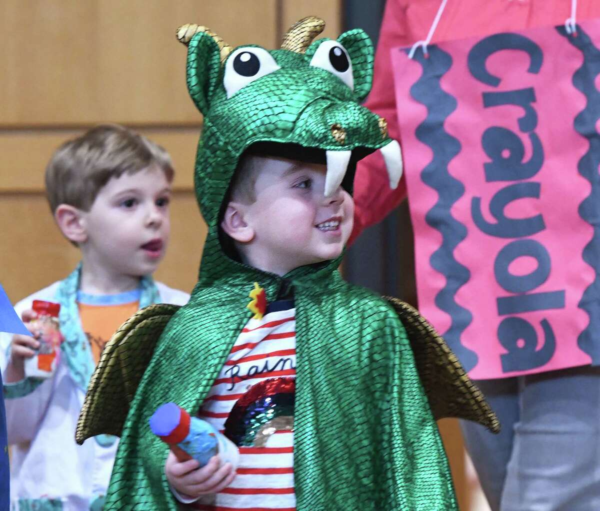 Preschooler Luca Hoffman is dressed as a dragon at the Preschool Purim Costume Parade at Temple Sholom in Greenwich, Conn. Tuesday, March 10, 2020. Youngsters from the Selma Maisel Nursery School paraded in costume around a crowd of parents to celebrate the Jewish holiday of Purim. The holiday is a celebration commemorating the saving of the Jewish people from the Persian emperor Haman.