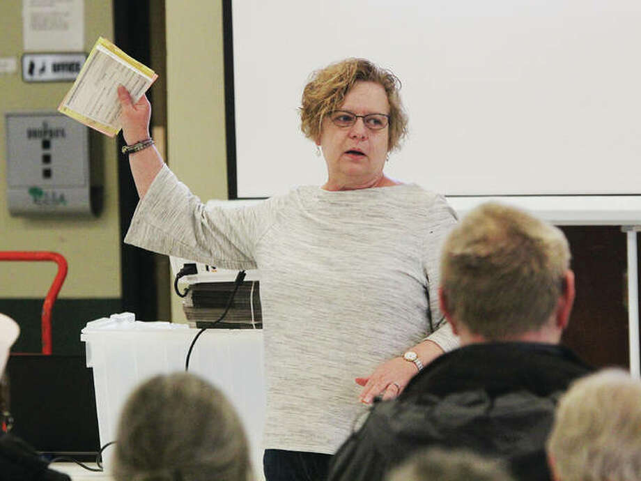 Madison County Deputy Clerk Mary Davis gives election judges instructions during training Tuesday morning at the Wood River Roundhouse. The clerk's office this week will train about 1,100 judges at seven different sessions throughout the county in preparation for the March 17 primary.