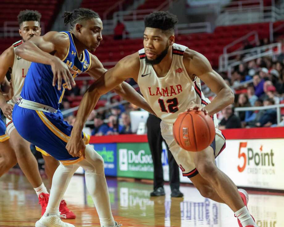 V.J. Holmes (12) drives to the basket in the second half. The Lamar Cardinals came back to tie up the game against the McNeese Cowboys on March 7, 2020 but lost the season finale in the final seconds of the contest. 