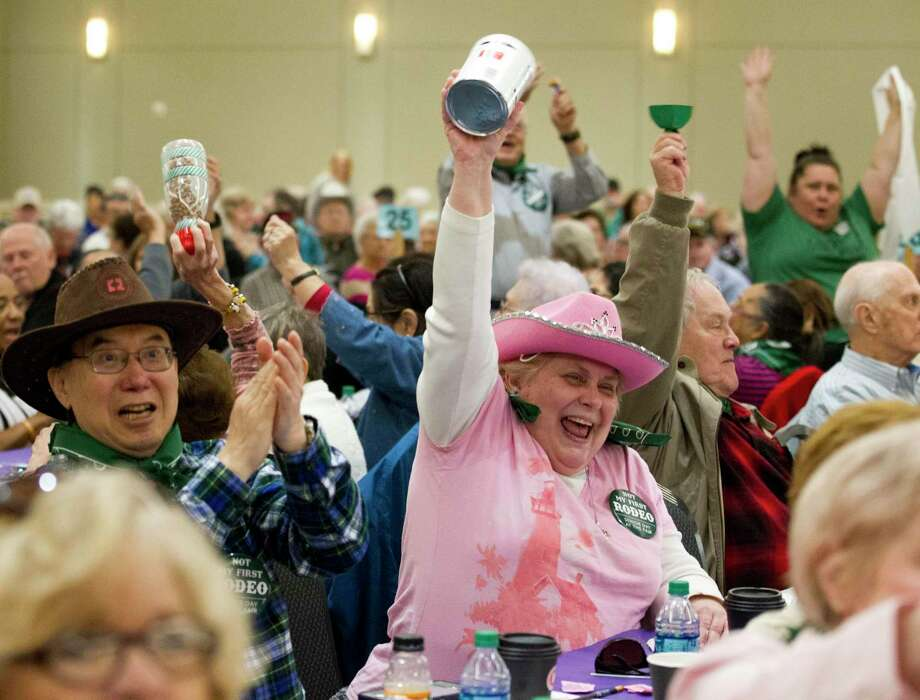 Carolyn Snyder reacts as residents of The Woodlands Community Center as William Dovan and Dorris Dromgoole are named king and queen of Senior Citzens Day at the Montgomery County Fair and Rodeo, Tuesday, April 2, 2019, in Conroe. Photo: Jason Fochtman, Houston Chronicle / Staff Photographer / © 2019 Houston Chronicle