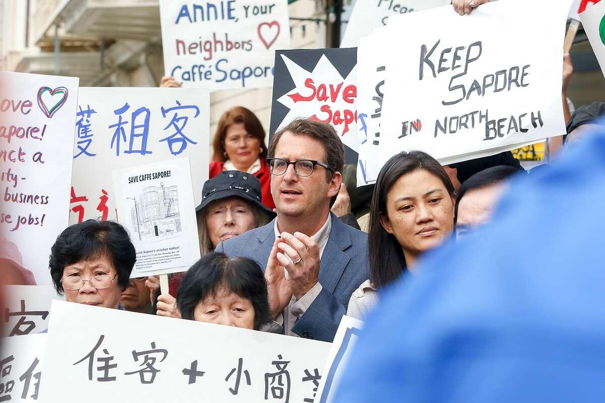 Supervisor elect, Dean Preston, joins Aaron Peskin and Senator Scott Wiener at a demonstration in support of saving Caffe Sapore in San Francisco, Calif. on Thursday, Nov. 14, 2019.