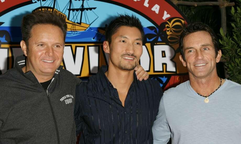 "Mark Burnett, Yul Kwon, winner of ""Survivor: Cook Islands"" and Jeff Probst in 2006. Photo: Michael Tran Archive/FilmMagic"