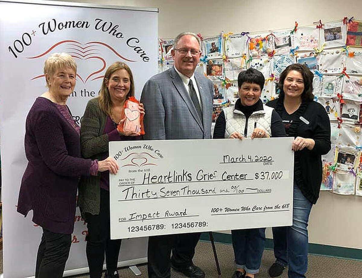 100+ Women Who Care from the 618 presented a $37,000 check to Heartlinks Grief Center at Family Hospice in Belleville on March 4. Heartlinks was the recipient of the women's collective giving group's third quarterly impact meeting on Jan. 24 at the Leclaire Room. From left to right are Pat Schmeder, Heartlinks director Diana Cuddeback, Belleville Mayor Mark Eckert, Barbara Whitehead and Suzanne Whitehead. 100+ Women has facilitated the giving of more than $114,000 in three quarterly meetings, with its next meeting scheduled for April 30 at the Leclaire Room.