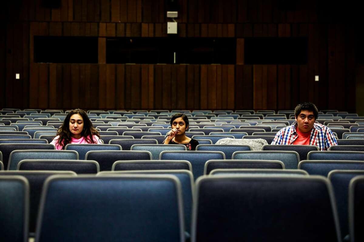 (L-r) Students Sarina Sabouri, 19, Vainavi Viswanath, 18, and Bryan Ngo, 18 attend a Linear Systems class in Wheeler Hall despite UC Berkeley announcing that they were suspending all in-person classes due to the coronavirus on Tuesday, March 10, 2020 in Berkeley, California. Their class usually has over 300 people in attendance.