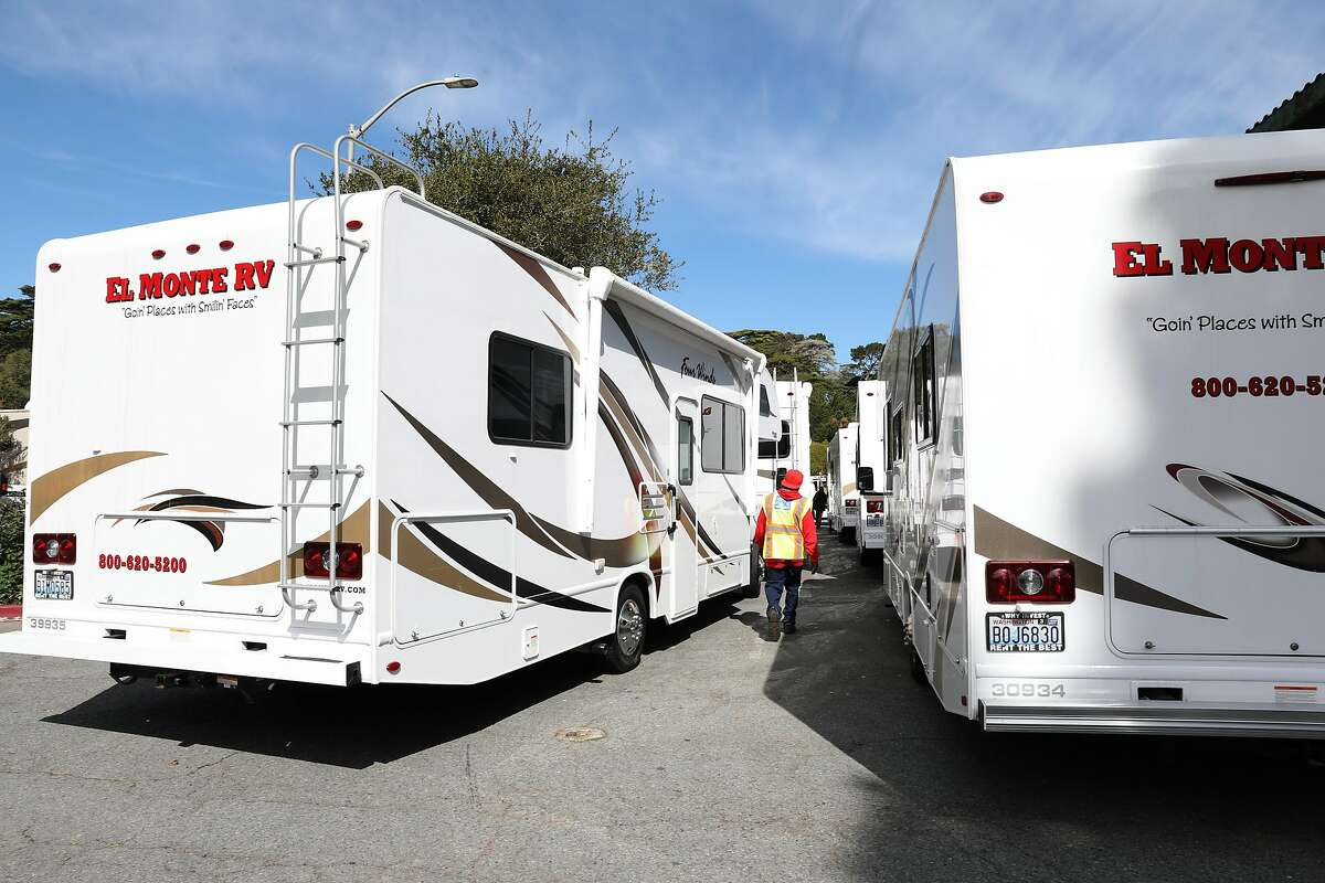 About thirty RVs are being rented to house people diagnosed with COVID-19 if they have no other place where they can safely self-quarantine seen at the Presidio on Tuesday, March 10, 2020, in San Francisco, Calif.