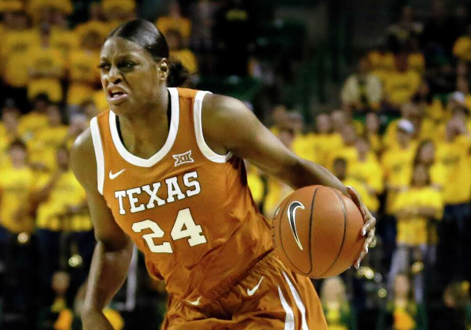 Texas forward Joyner Holmes dribbles up court against Baylor during an NCAA college basketball game Thursday, March 5, 2020, in Waco, Texas. Baylor won 69-53. (AP Photo/Ray Carlin) Photo: Ray Carlin, FRE / Associated Press / Copyright 2020 The Associated Press. All rights reserved.