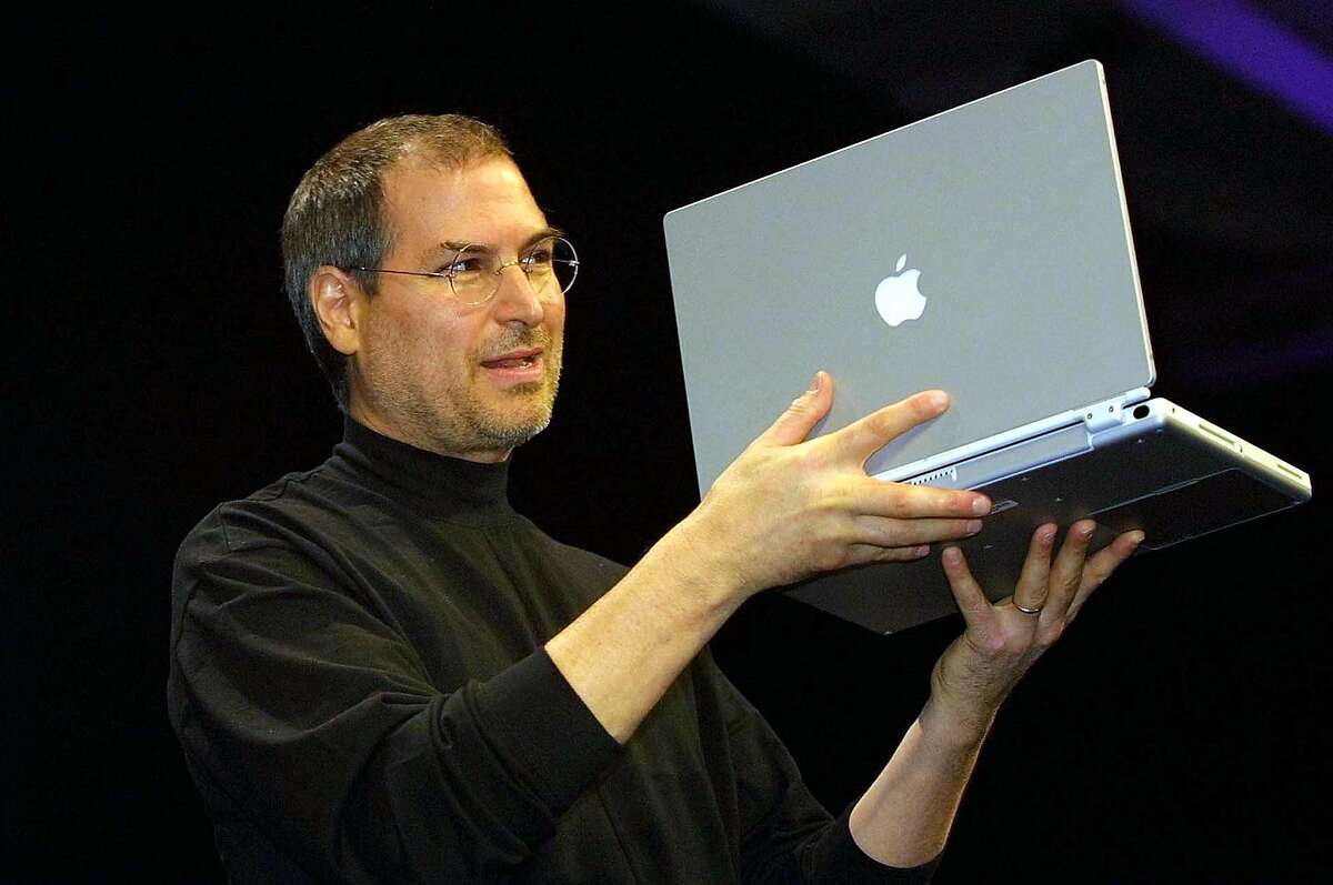 Steve Jobs, CEO of Apple Computer unveils a new titanium G4 Powerbook with a 15.2 inch screen during his keynote address at the MacWorld Expo in San Francisco,California, in this 09 January 2001 file photo.