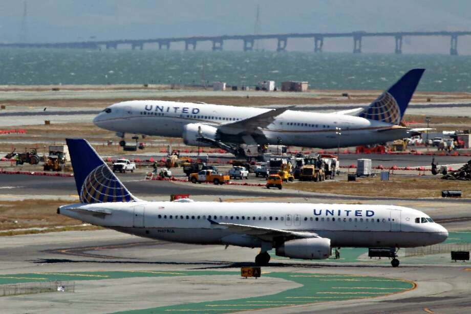 A leading climate scientist called for the complete phaseout of fossil fuels, making a reader wonder just how airplanes like these at San Francisco International Airport would take off. Photo: Lea Suzuki /San Francisco Chronicle / ONLINE_YES