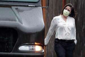 A worker at the Life Care Center in Kirkland, Wash., near Seattle, wears a mask earlier this month. Several people at the long-term care facility have died from the COVID-19 coronavirus. The spread of the virus could open our hearts for greater empathy for people in other distressing situations.