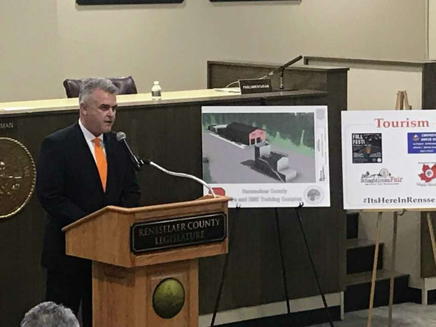 Rensselaer County Executive Steve McLaughlin elivers his third state-of-the-county address Tuesday March 10, 2020 to the County Legislature in the county office bulding in Troy, New York flanked by a rendering of the new county fire training center.
