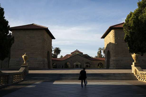 STANFORD, CA - MARCH 09: A person walks towards the main quad during a quiet morning at Stanford University on March 9, 2020 in Stanford, California. Stanford University announced that classes will be held online for the remainder of the winter quarter after a staff member working in a clinic tested positive for the Coronavirus. (Photo by Philip Pacheco/Getty Images)