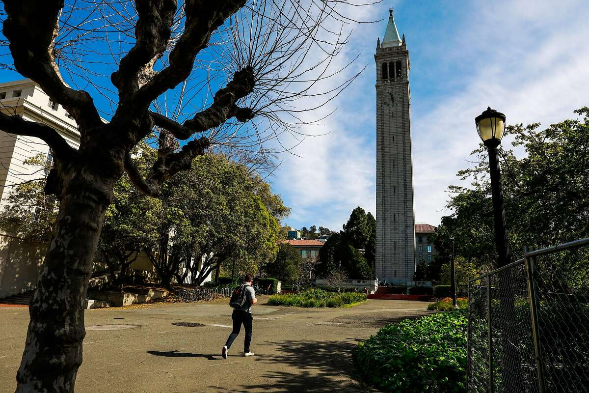 A man walks through the UC Berkeley campus a day after Berkeley suspended in-person classes through the end of Spring break due to the coronavirus on Tuesday, March 10, 2020 in Berkeley, California.