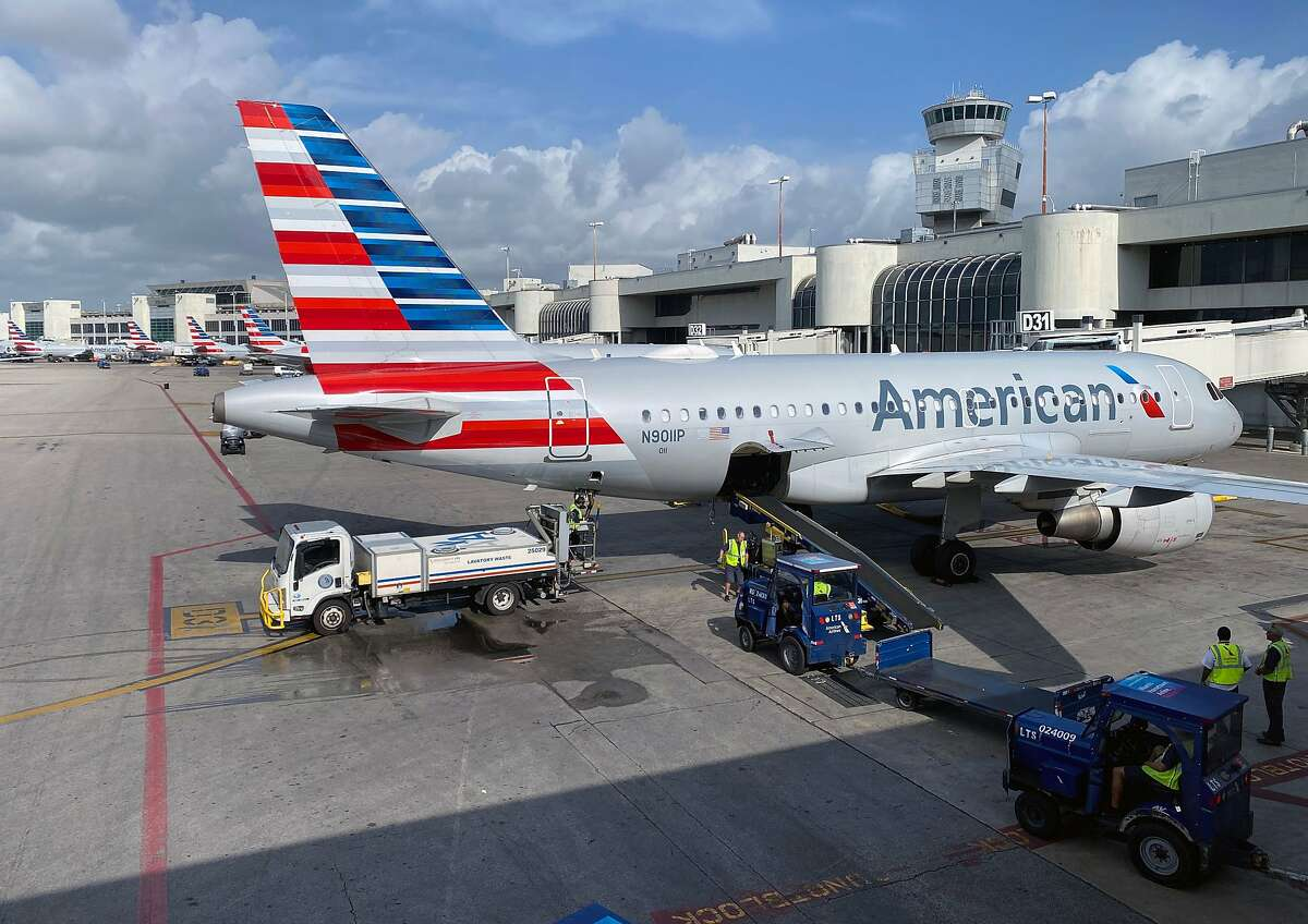 In this file photo American Airlines planes are seen at Miami International Airport (MIA) on March 3, 2020 in Miami, Florida. )