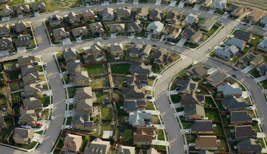 Refinancing applications have increased 479 percent from a year ago as mortgage rates hit rock bottom, according to the Mortgage Bankers Association. Photo: Rick Bowmer, STF / Associated Press / Copyright 2019 The Associated Press. All rights reserved