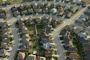 Refinancing applications tripled from a year ago as mortgage rates hit rock bottom.