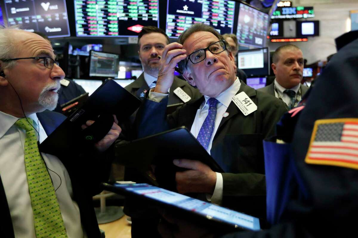 Sal Suarino, center, works with fellow traders on the floor of the New York Stock Exchange, Tuesday, March 10, 2020. Stocks, Treasury yields and oil are clawing back some of the plunge they took a day before, when the S&P 500 had its worst drop in more than a decade.