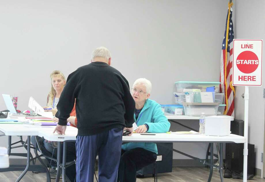 Election inspectors check a voter in at the Chippewa Hills Community Center. According to Clerk Kristin Lytle, voter turnout was higher than usual. (Pioneer photo/Catherine Sweeney)