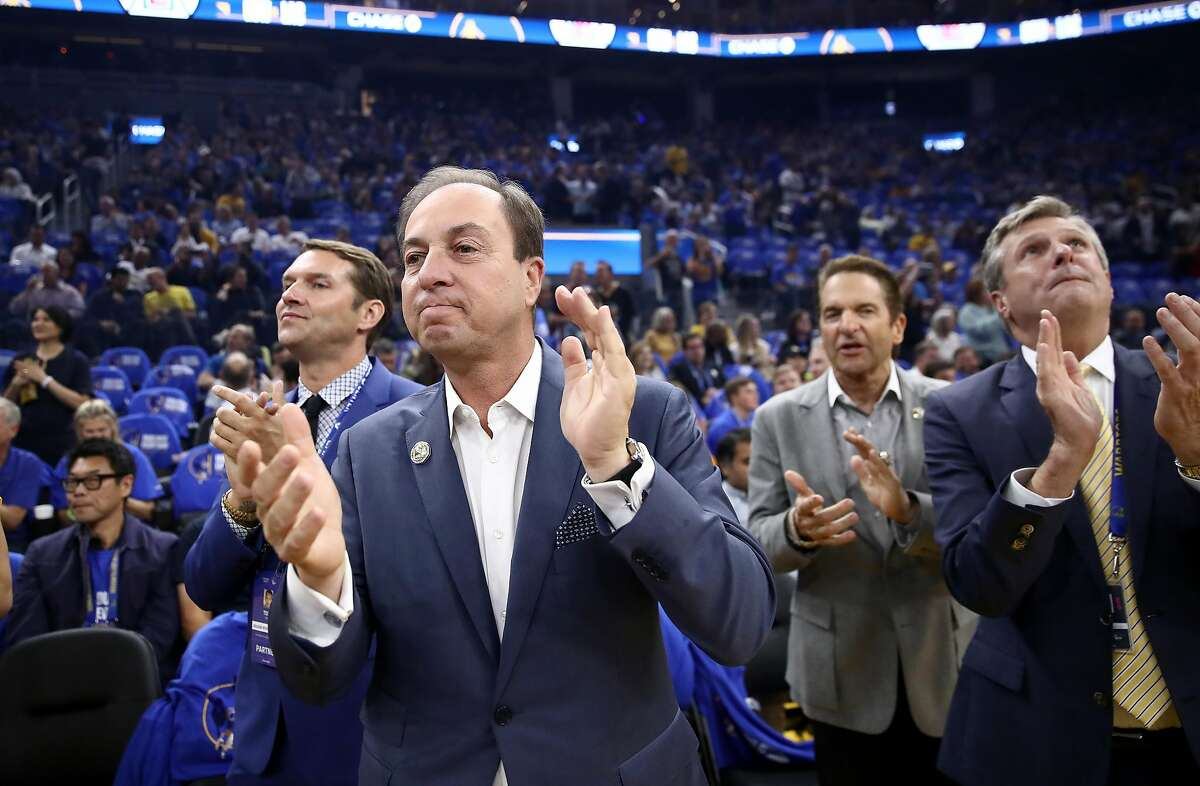 SAN FRANCISCO, CALIFORNIA - OCTOBER 24: (L-R) Golden State Warriors owners Joe Lacob and Peter Guber stand with team president and COO Rick Welts before their game against the LA Clippers at Chase Center on October 24, 2019 in San Francisco, California.