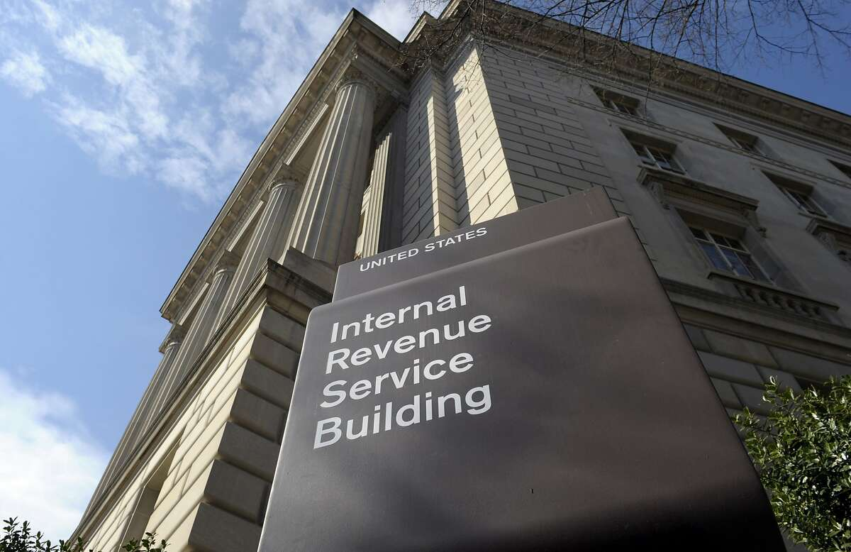 FILE - In this photo March 22, 2013 file photo, the exterior of the Internal Revenue Service (IRS) building in Washington. A tax bill can be a frightening and unexpected burden. Owing the IRS isn't fun, sure, but handling your debt the right way prevents more expenses and trouble. Then, you can take a simple step to avoid a tax bill next year. (AP Photo/Susan Walsh, File)