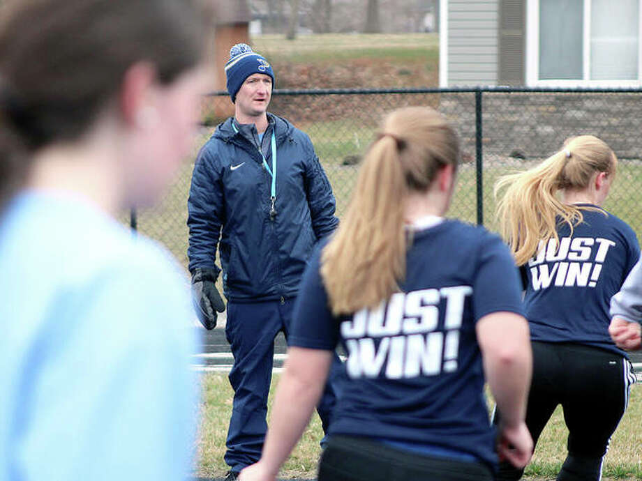 Jersey soccer coach Scott Burney watches his team go through drills Tuesday at JCHS. Burney, who's also the boys soccer coach at JCHS, is in his first season as the Panthers girls coach.